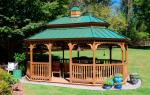 Wood gazebo with a green metal roof