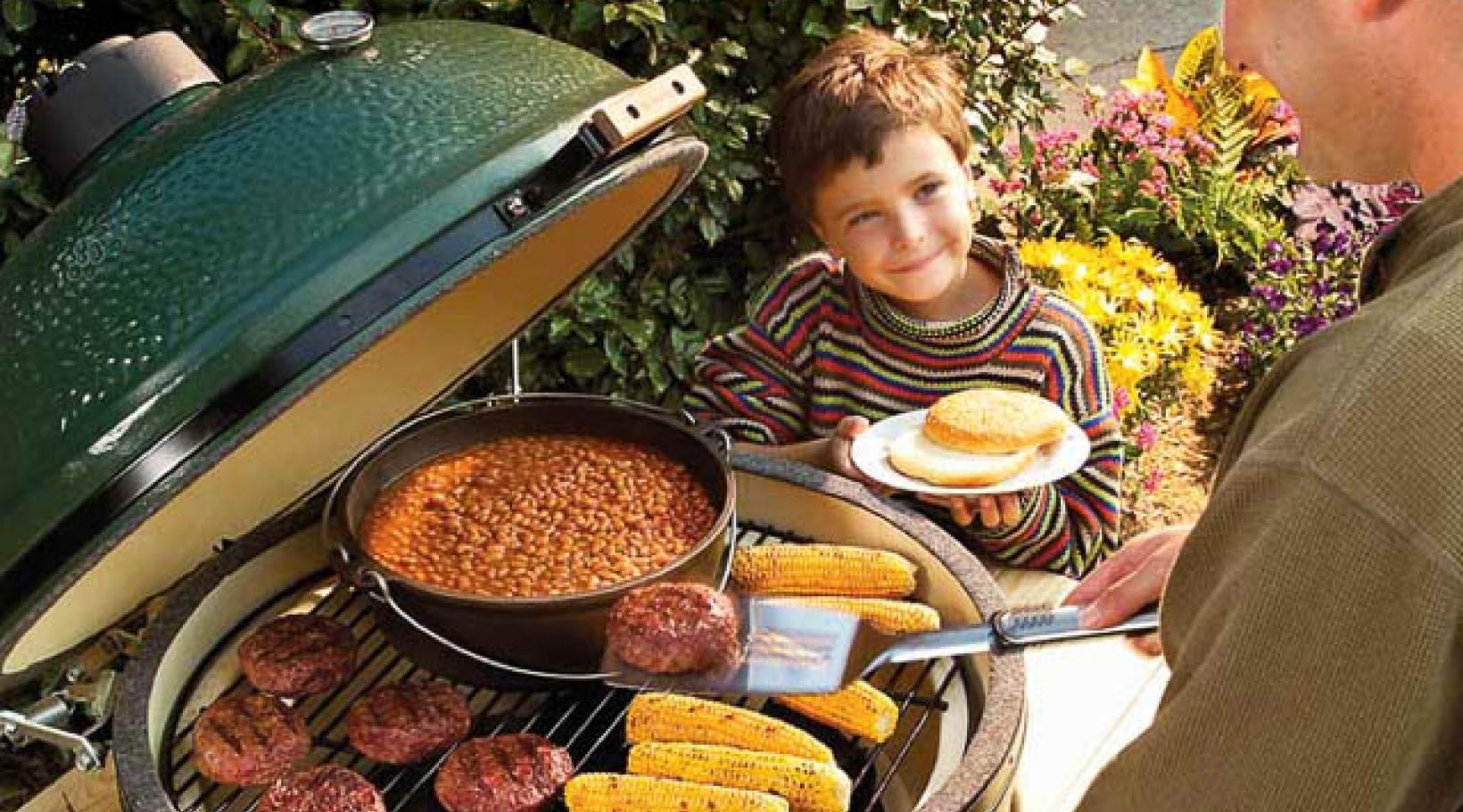 Man cooking food on Green Egg Grill