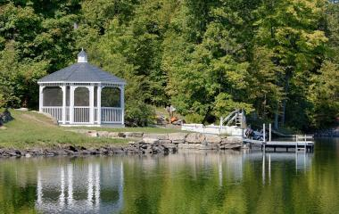 16' Octagonal Country Style White Vinyl Gazebo with Gray Rubber Slate, Screens and Cupola