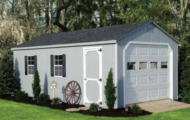 Wooden A frame garage with man door, two windows, and wooden ramp