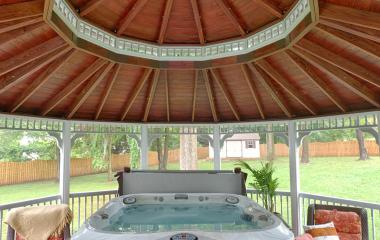 Inside a 20' Dodecagon country style vinyl gazebo with screens