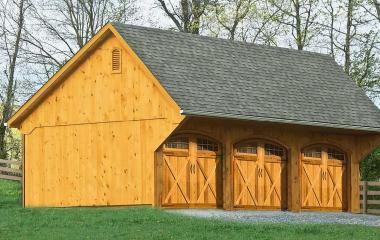 Wooden Quaker style three car garage