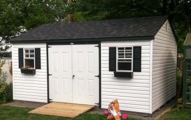 Vinyl a-frame storage shed with double steel doors and two windows