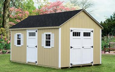 Wooden a-frame storage shed with double end doors, one side door, and two windows