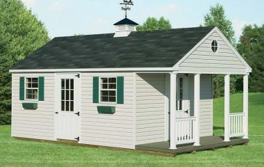 Vinyl cape cod shed with porch, cupola, 2 9-lite doors, and two windows with shutters and flowerboxes