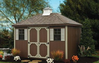 Wooden hip roof storage shed with cupola
