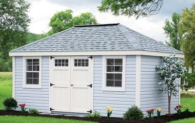 Vinyl hip roof storage shed with wooden double doors and trim