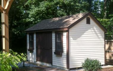 Wooden cape cod storage shed with gable vents