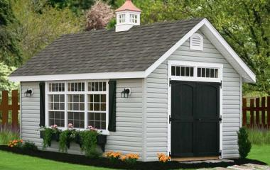 Vinyl cape cod storage shed with transom windows, wooden double door, gable vents and cupola