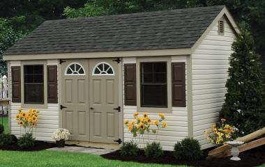 Vinyl cape cod storage shed with two windows, double doors, and gable vents