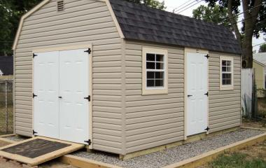 Vinyl Dutch Barn style Storage Shed with wooden ramp