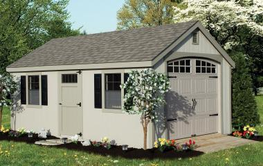 Wooden Cape cod garage with wooden ramp, side door, two windows, and gable vents
