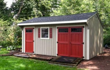 Wooden quaker storage shed with single door, window, and double doors
