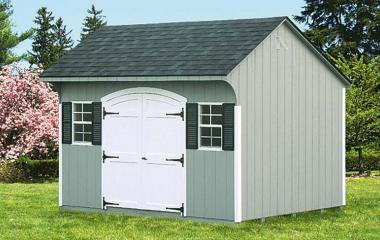 Wooden quaker style storage shed with double doors and two windows