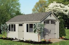Vinyl cape cod garage with side door and two windows