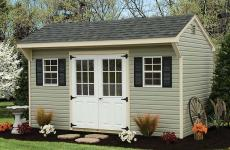 Vinyl quaker style storage shed with 9-lite steel slab double doors, two windows and gable vents