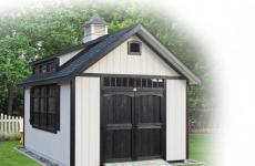 Wooden cape cod storage shed with double doors, gable vents, transom dormer, and cupola