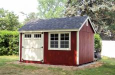 Wooden cape cod storage shed with double doors and double windows