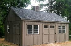 Wooden board and baton cape cod storage shed with cupola, two sets of double doors, and three windows