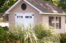 Vinyl cape cod storage shed with steel slab double doors