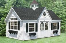 Vinyl cape cod storage shed with double doors, three windows with flower boxes, dormer, cupola, and transom windows