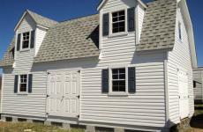 Two story Vinyl Dutch Barn Storage Shed with two dormers and two sets of double doors