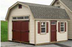 Vinyl Dutch Barn style storage shed with double doors, man door, transom windows, gable vents, and two windows