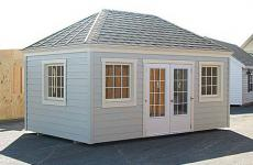 Vinyl hip roof storage shed with double 12-lite doors