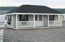 Vinyl hip roof storage shed with porch