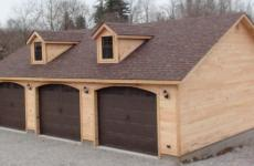 wooden A frame three car garage two dormers