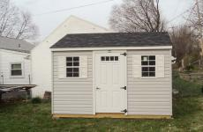 Vinyl a-frame storage shed with 4-lite door and two windows