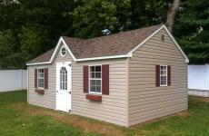 Vinyl A-Frame style Storage Shed with dormer, three windows, and single door