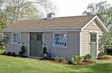 Vinyl a-frame storage shed with wooden double doors, wooden single door, gable vents, four windows, and cupola
