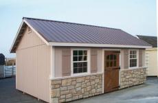 Wooden a-frame storage shed with stone skirting and metal roof
