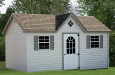 Vinyl cape cod storage shed with 10-lite steel door, two windows, dormer, and gable vents