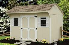 Wooden quaker style storage shed with gable vents, double doors, and two windows