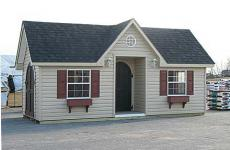Vinyl cape cod storage shed with dormer, two windows with flower boxes, and wooden arched doors
