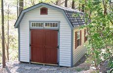 Vinyl Dutch Barn style storage shed with double doors, gable vents and two windows