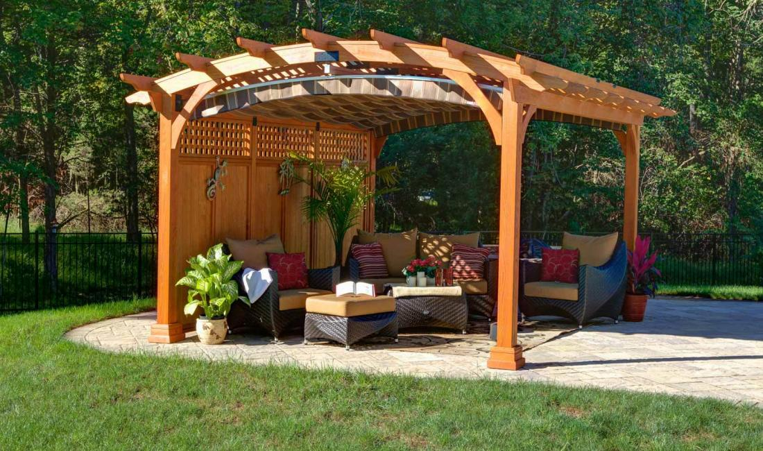 12x15' Hearthside Pergola in Canyon Brown Stain with Lattice Roof, Privacy Wall and EZ-Shade Canopy
