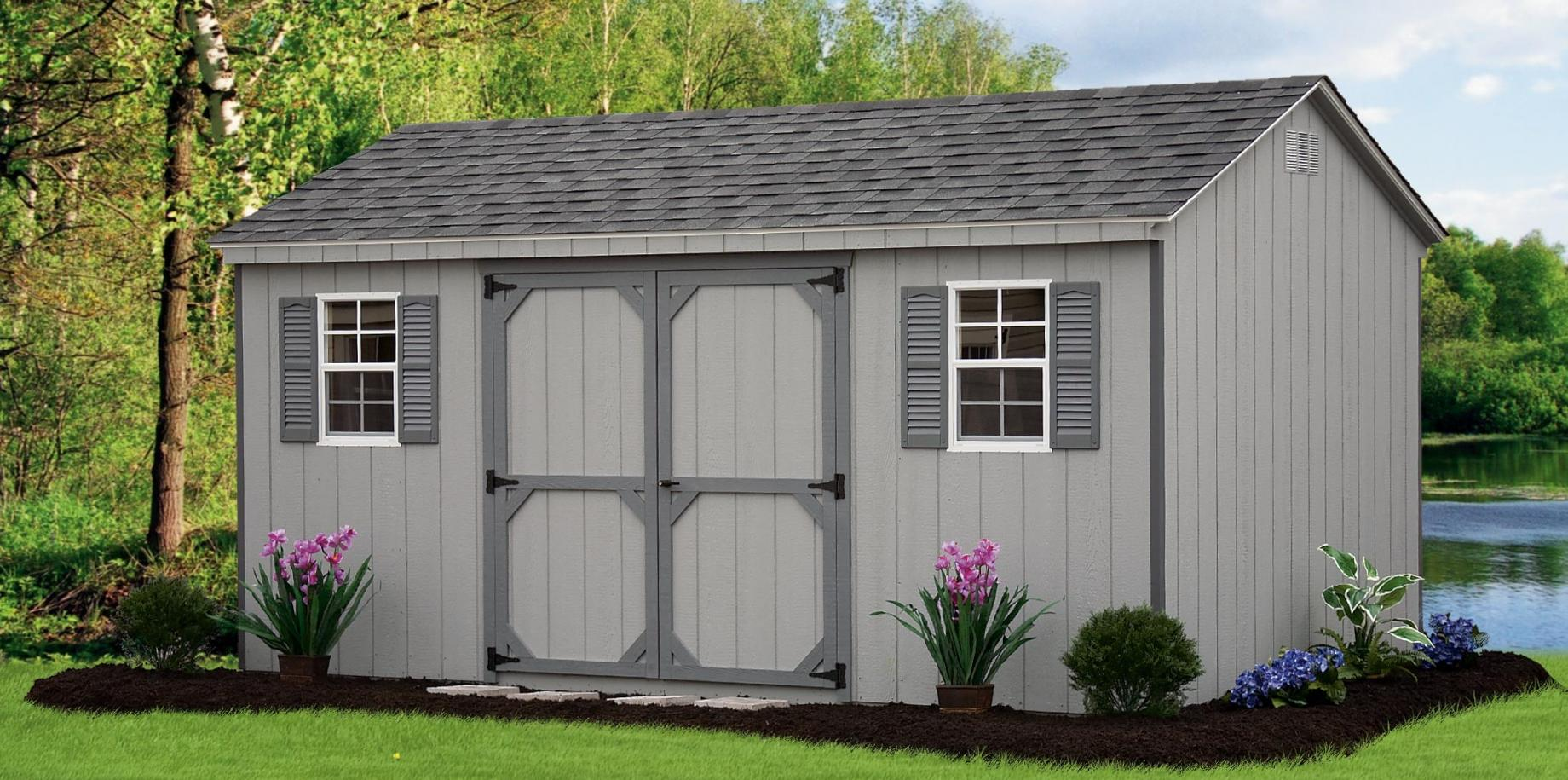 Wooden A-Frame style shed with wood siding.