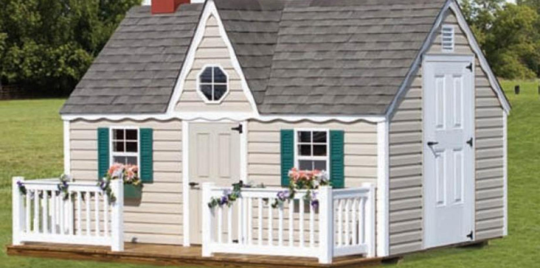 Victorian playhouse with vinyl siding.