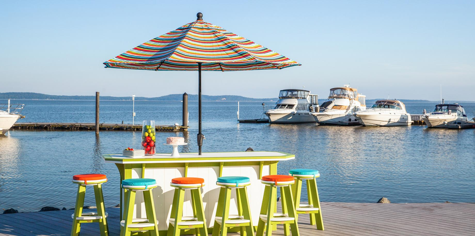 A lime green bar with 6 bar stools on a dock - Finch Outdoor Furniture