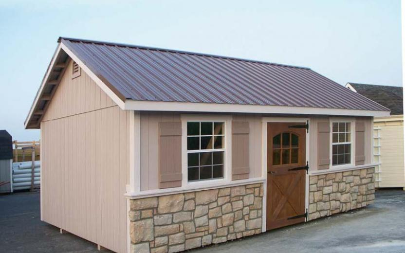 Wooden A Frame Storage Shed With Stone Skirting And Metal Roof