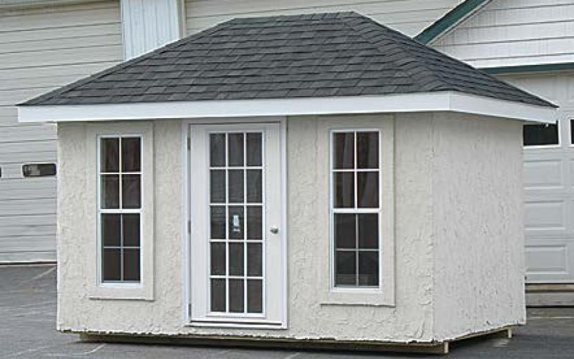 Hip roof storage shed with 15-lite door and two 8-lite windows & Hip Roof Barns | River View Outdoor Products