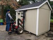 man moves shed with mule